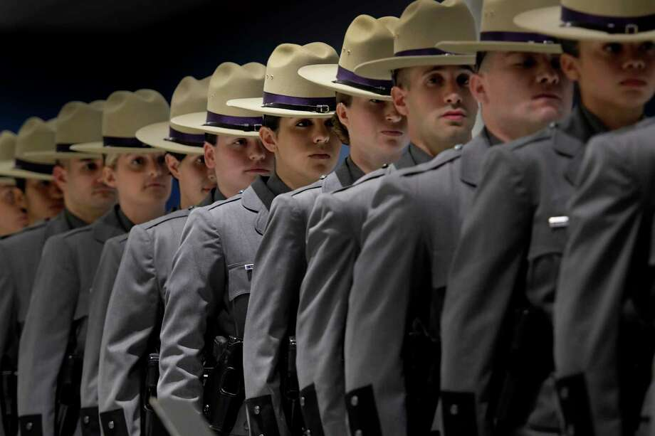 """Protecting New York to the core, we are the 204"" was the mantra of the 226 troopers who received their diplomas during the 204th Basic School Graduation ceremony at the Empire State Plaza Convention Center on Oct. 13, 2016 in Albany. (Skip Dickstein/Times Union) Photo: SKIP DICKSTEIN / 20038365A"