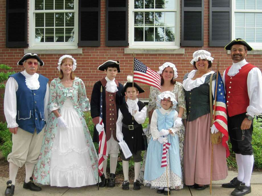 Patriot John Adams visits with Colonists during a July Fourth reenactment at Trumbull Town Hall. Photo: Trumbull Town Hall / Contributed Photo