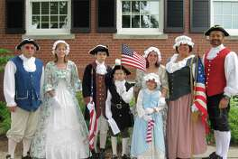 Patriot John Adams visits with Colonists during a July Fourth reenactment at Trumbull Town Hall.