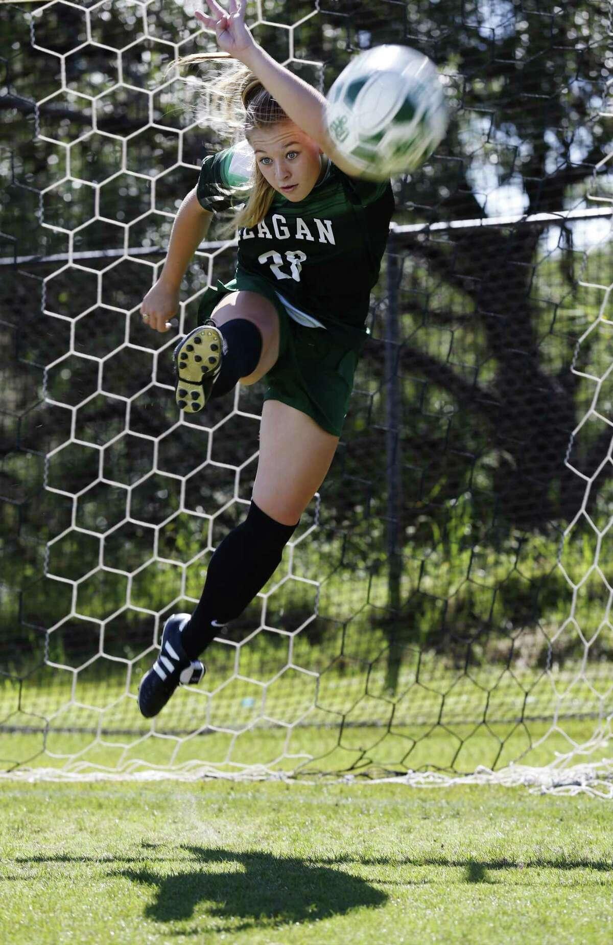 Reagan soccer star Taylor Olson strikes the ball during a photo shoot in 2017.