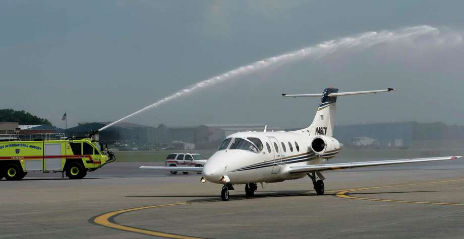 The first One Jet Air flight arrives at the Albany International Airport to a water salute from the  Airport Fire department Friday June 23, 2017 at Colonie, N.Y.  (Skip Dickstein/Times Union) Photo: SKIP DICKSTEIN, Albany Times Union / 20040817A