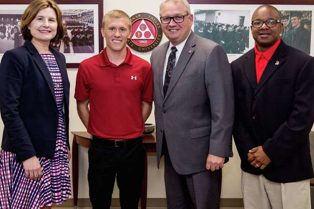 p.p1 {margin: 0.0px 0.0px 0.0px 0.0px; line-height: 10.8px; font: 10.0px Helvetica}  Joey Southgate was recognized by the SVSU Board of Control for his All-American honor during the Board's meeting Monday. He is pictured with from left, Board chair Jenee Velasquez, SVSU President Don Bachand, and SVSU track and field head coach Rod Cowan. (Courtesy Photo)
