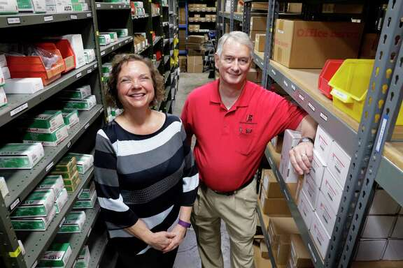 Carole Cook, CEO, and Larry Davis, president, in the warehouse of Industrial Equipment Company in Houston, TX, June 21, 2017. (Michael Wyke / For the  Chronicle)