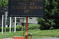 An electronic sign at the intersection of Sawmill Road and Route 37 announces the closure of Sawmill Road, in New Fairfield. Sawmill will be closed on June 26th. The closing is expected to last a week while a drainage problem is addressed. Thursday, June 22, 2017, in New Fairfield, Conn.