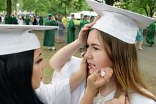 Alyssa Maldona, left,  helps classmate Alyssa DeVoe with her makeup before Commencement exercises for Shenendehowa High School Class of 2017 at SPAC Friday June 23, 2017 in Saratoga Springs, NY.   (John Carl D'Annibale / Times Union)