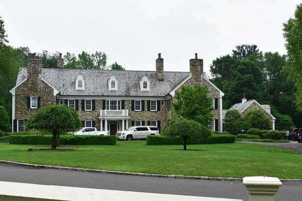 Contractors congregate at 705 West Rd. in New Canaan, Conn., on Friday, June 23, 2017, two days after General Electric CEO Jeff Immelt sold his longtime home for $4 million.