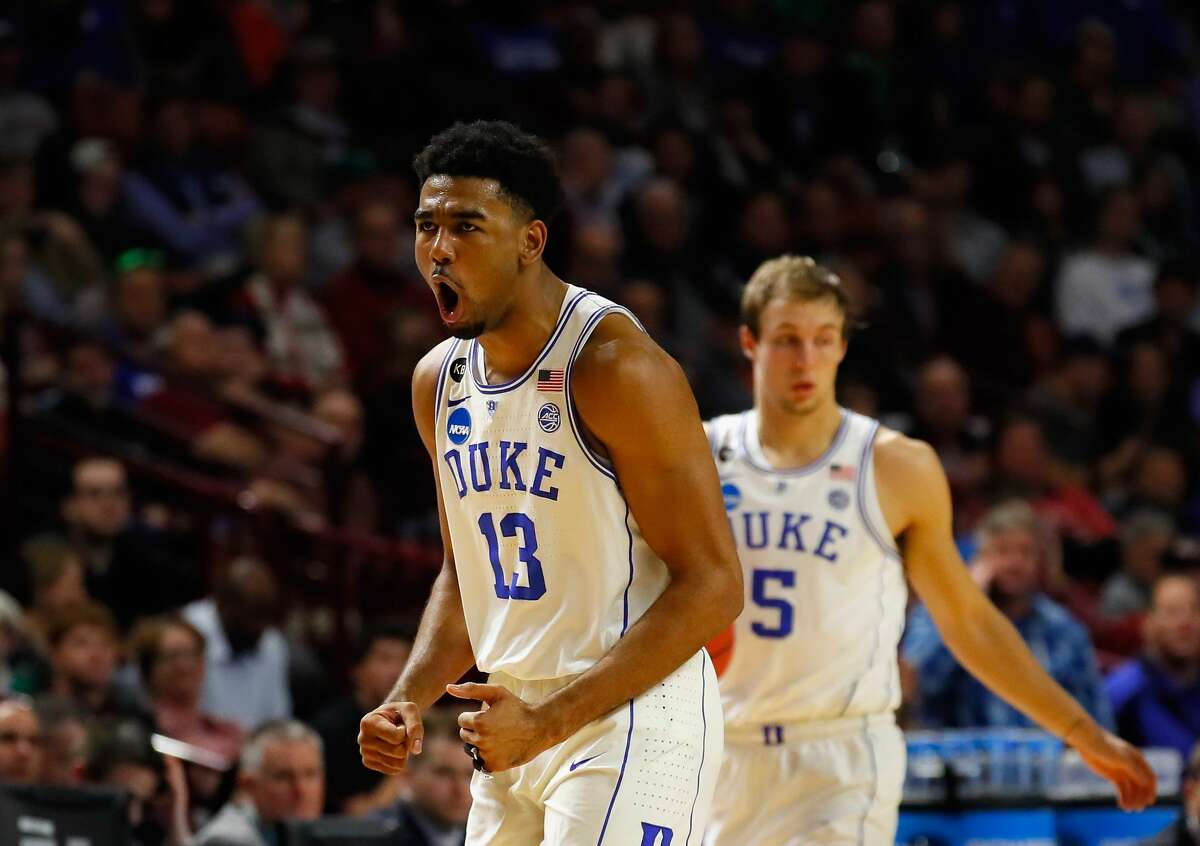 GREENVILLE, SC - MARCH 17: Matt Jones #13 of the Duke Blue Devils reacts after forcing a turnover in the second half against the Troy Trojans during the first round of the 2017 NCAA Men's Basketball Tournament at Bon Secours Wellness Arena on March 17, 2017 in Greenville, South Carolina. (Photo by Kevin C. Cox/Getty Images)