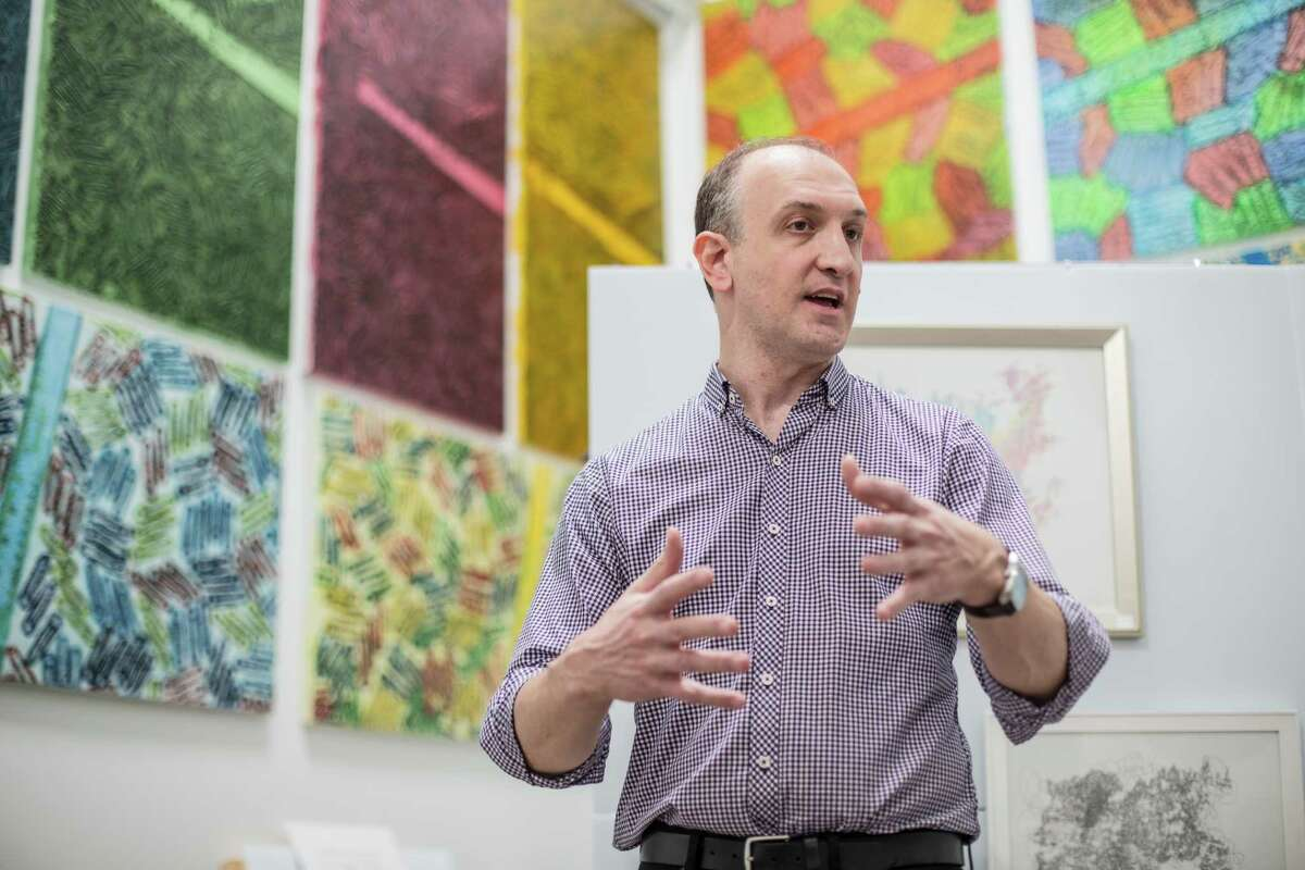 Artist and former software engineer John Hovig urges potential art buyers to relax and don't be afraid to engage in conversation about the piece they're interested in.