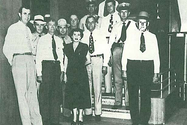 Pictured are Sheriff Fannie Pearl Surratt, center, and her officers in 1949. First row left to right, Bill DeArmond; E.L. McDuffie, Ed Damuth; Second row: Jimmy Casper, Le Roy Beavers, Fred Bull Sr.; Third row: Joe White, Fred Bull; Fourth row: Pete Telford, Hollis Bowden; fifth row: Les Doughtie.