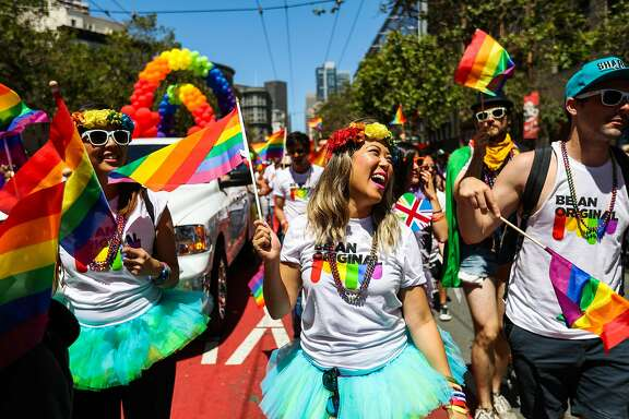 Kimberly Pickup (center) carries flags as she walks with the Netflix team during the 46th annual LGBT Pride Parade, in San Francisco, California, on Sunday, June 26, 2016.