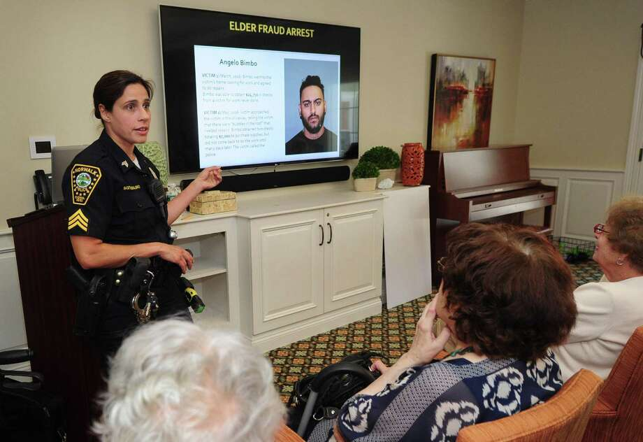 Sgt. Sofia Gulino gives a presentation of senior scams and fraud to a group of seniors Thursday at Brightview Senior Living on New Canaan Avenue in Norwalk. Photo: Erik Trautmann / Hearst Connecticut Media / Norwalk Hour