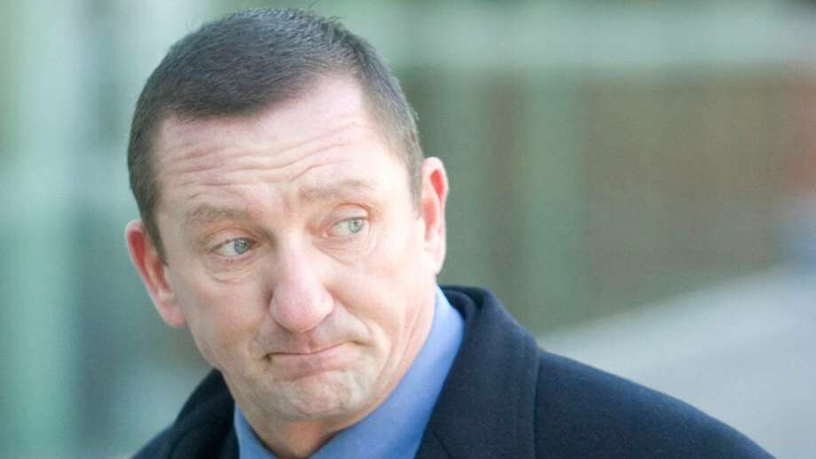 Former Norwalk police lieutenant Thomas Cummings arrives at Superior Court in Stamford, on Thursday, Feb. 14, 2008. Cummings took a plea deal on the eve of his trial Wednesday. Photo: File Photo / Stamford Advocate File Photo