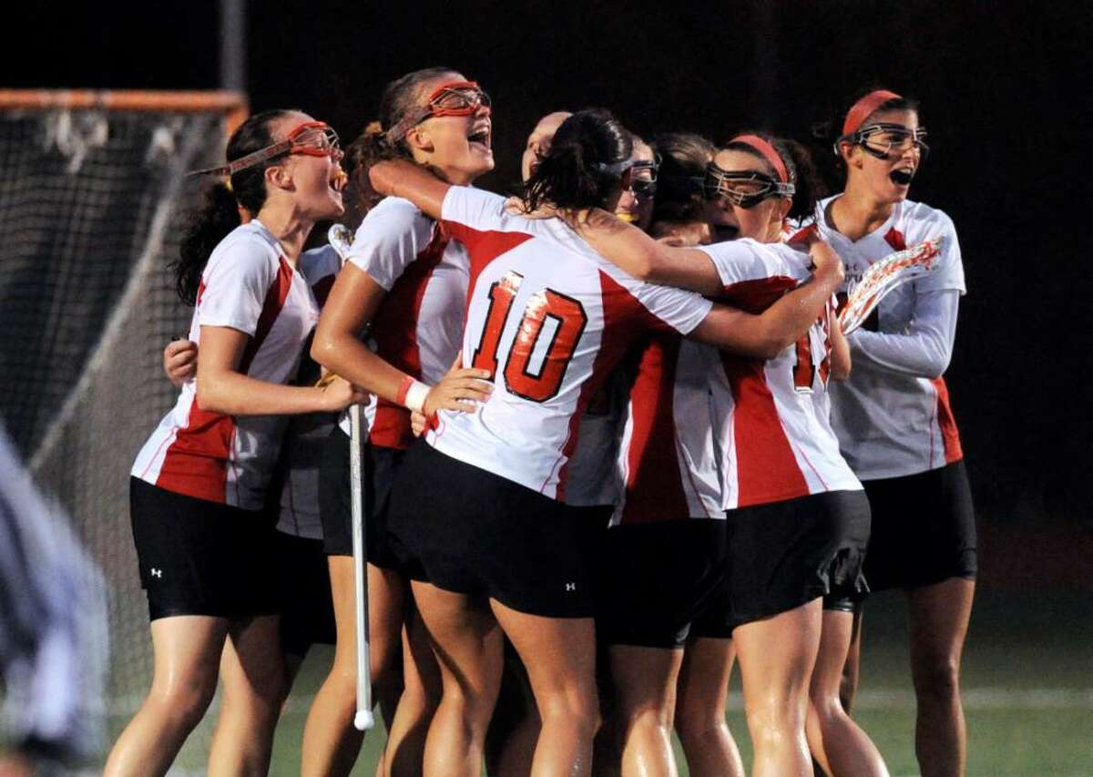 The Greenwich High School Cardinals celebrate an 11-9 victory over Darien High School, June 9, 2010 at Fairfield Warde High School, during the Girls Lacrosse Division I State Semifinals.