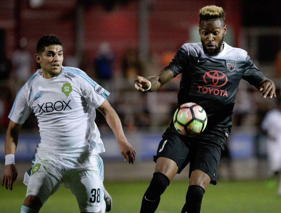 San Antonio FC's Sebastien Ibeagha (right) controls the ball during a United Soccer League match against Seattle Sounders FC2 on May 13, 2017, at Toyota Field. Photo: Darren Abate /USL / Darren Abate Media LLC