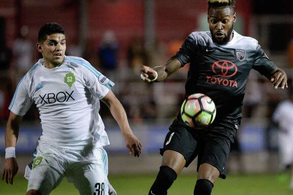 San Antonio FC's Sebastien Ibeagha (right) controls the ball during a United Soccer League match against Seattle Sounders FC2 on May 13, 2017, at Toyota Field.