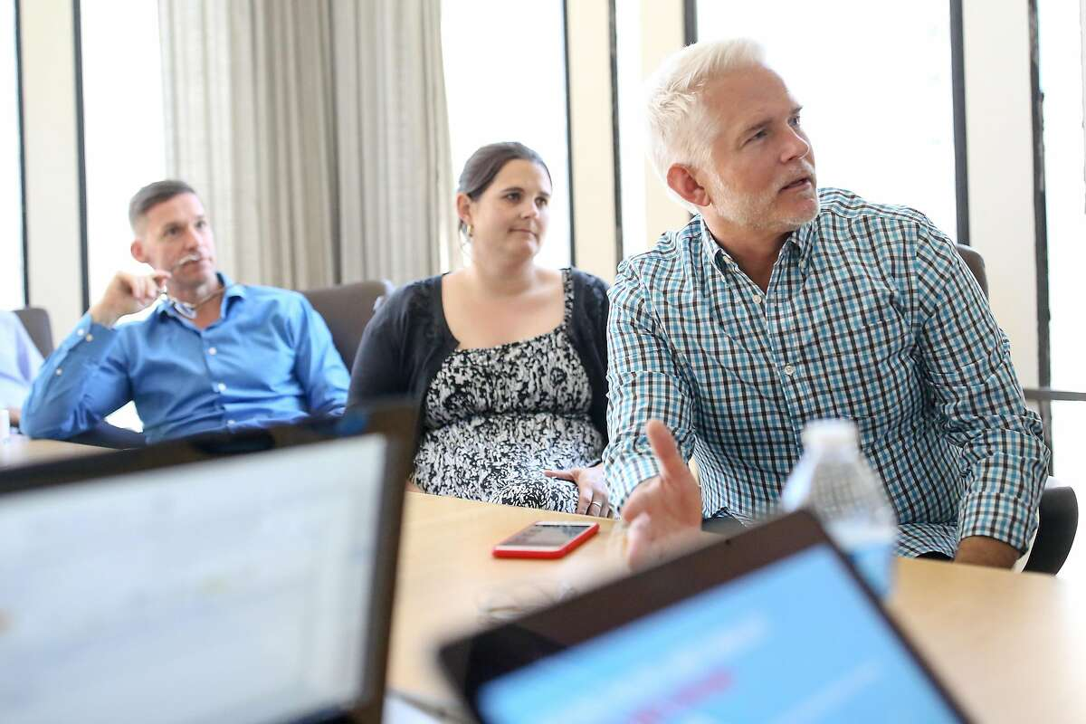 Peter Sisson (right), the entrepreneur in residence at StartOut gives feedback during a practice pitch on Tuesday, June 20, 2017 in San Francisco, Calif.