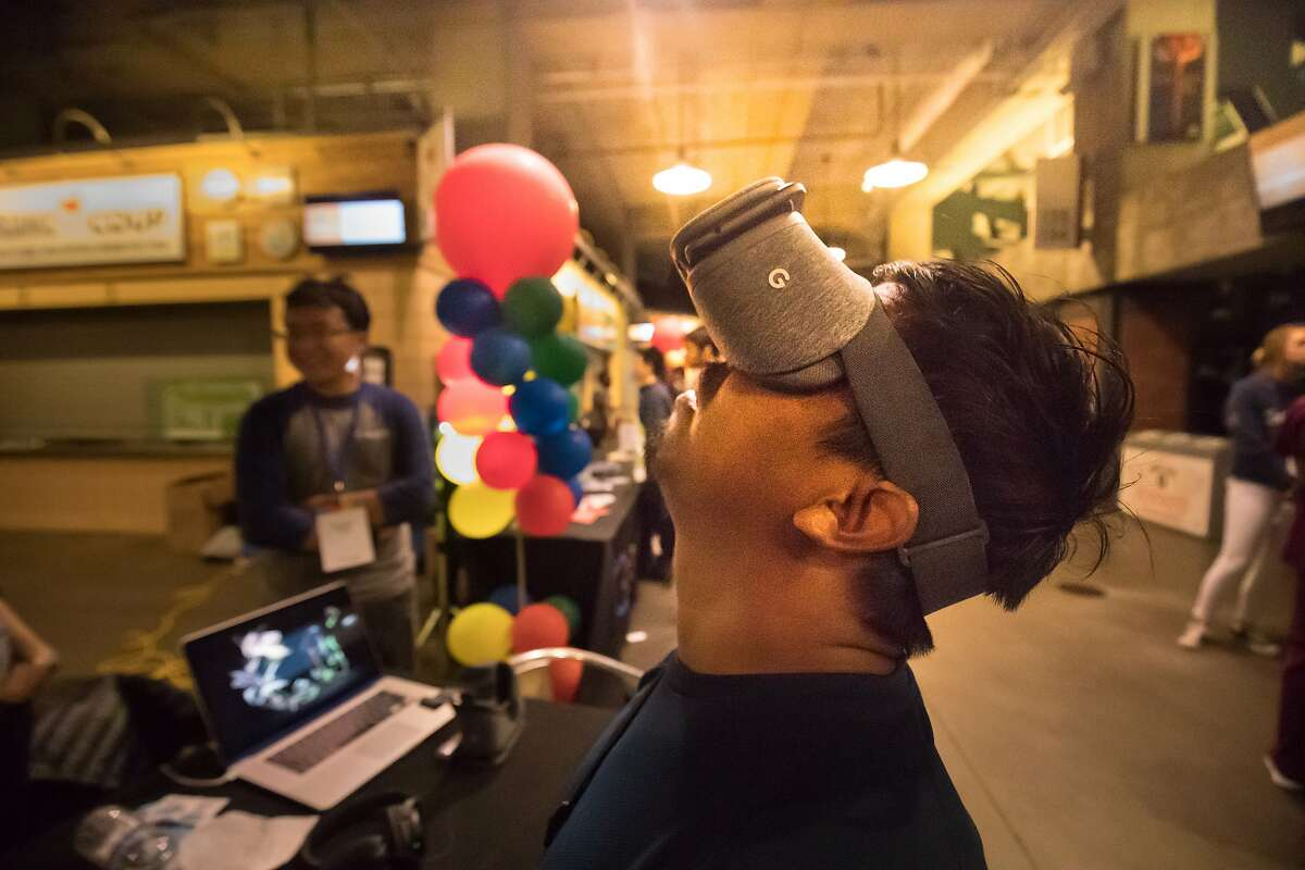 Antonio Jimenez tries out a virtual reality display at Google's booth at Internapalooza held at AT&T Park on Wednesday, June 21, 2017 in San Francisco, CA.