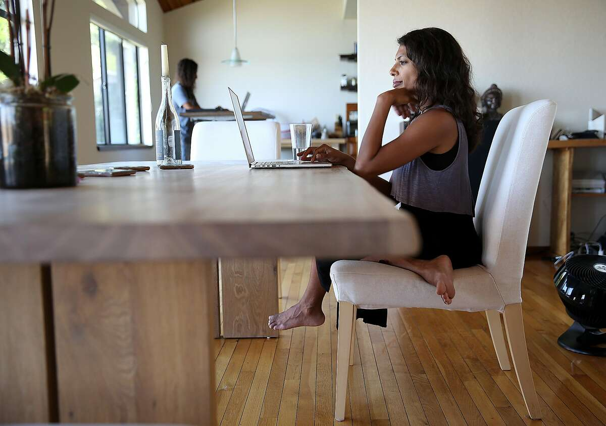 CEO Prerna Gupta (right) and her husband CTO Parag Chordia (back left) work at home on Hooked, a company redefining fiction for the Snapchat generation, on Thursday, June 22, 2017, in Brisbane, Calif.