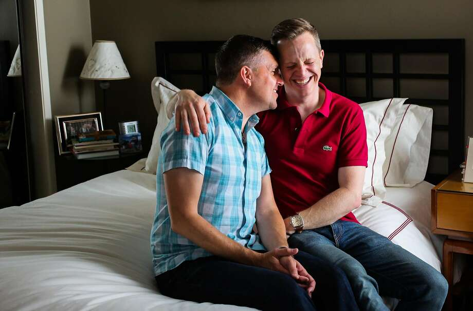 Shad St. Louis (left) and husband Christopher Shields sit for a portrait in their bedroom in the Castro district in San Francisco. Photo: Gabrielle Lurie, The Chronicle
