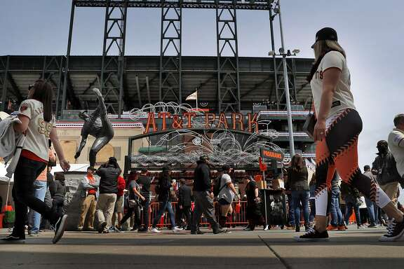 Fans walk past the Juan Marichal statue at the Lefty O'Doul gate before the San Francisco Giants played the Arizona Diamondbacks on opening day at AT&T Park in San Francisco, Calif., on Monday, April 10, 2017.