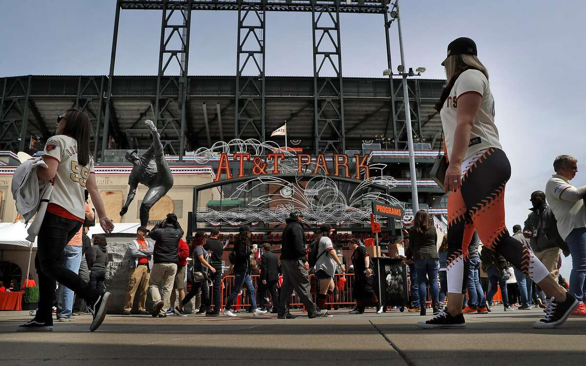 FILE-- Fans walk past the Juan Marichal statue at the Lefty O'Doul gate before the San Francisco Giants played the Arizona Diamondbacks on opening day at AT&T Park in San Francisco on Monday, April 10, 2017.