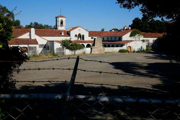 The dilapidated officers club building still stands on the property where the City of Oakland is proposing a mixed use community plan project  at the site of the closed Oak Knoll Naval Medical Center Oakland as seen on Friday June 23, 2017, in Oakland, Ca. The project includes the construction of 935 residential units.