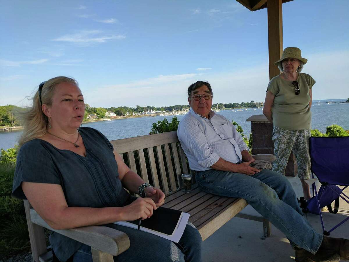 Jane Kochersperger (front), Bob Brady and Troudy Grouse talk about how Greenwich Conservation Advocates was formed in response to the state's drought at a meeting with other GCA members and the Greenwich Time at Cos Cob Park on Thursday evening.