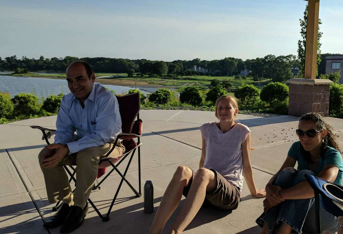 Rick Margenot (left), Marija Mikolajczak (middle) and Anitra Brooks Kocyba (right) talk about Greenwich Conservation Advocates and the grassroot organization's current and future plans under the pavilion at Cos Cob Park early Thursday evening.