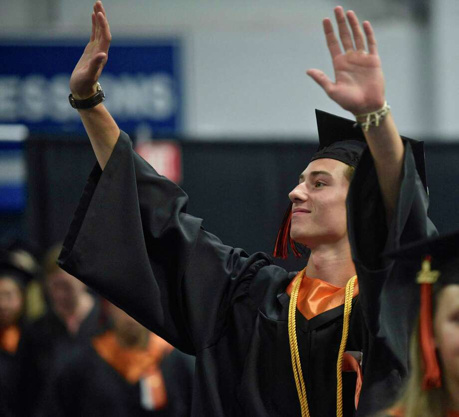 Jake Barrett waves to his family during the processional for the One Hundred and First Ridgefield High School Annual Commencement, Class of 2017, at the William A. O'Neill Center, western Connecticut State University, Danbury, Conn, Friday, June 22, 2017. Photo: H John Voorhees III, Hearst Connecticut Media / The News-Times