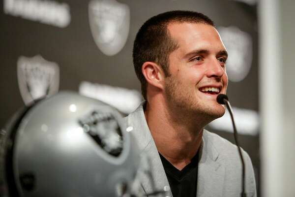 Derek Carr, quarterback for the Oakland Raiders, speaks at a press conference about his $125 million dollar contract extension at the Oakland Raiders Facility in Oakland on Friday, June 23, 2017.