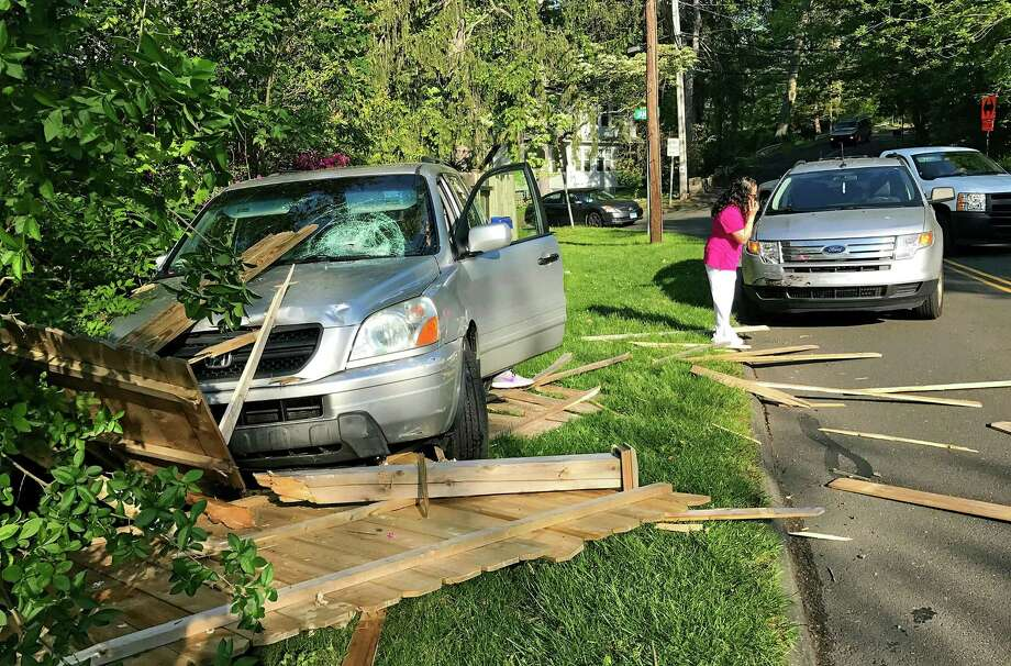 A vehicle crashed into the fence at a residence on Perry Avenue in the Silvermine section of Norwalk on May 17. People have turned to Norwalk police for help reducing speeding along Silvermine Avenue, Perry Avenue and James Street. About two-dozen raised their concerns during a meeting at police headquarters on Thursday. Photo: Contributed Photo / Contributed Photo / Norwalk Hour contributed