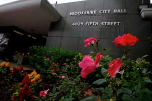 The flowers in front of the Brookshire City Hall are seen on Friday, May 15, 2009, in Brookshire, where officials have been investigated for corruption. ( Julio Cortez / Chronicle )