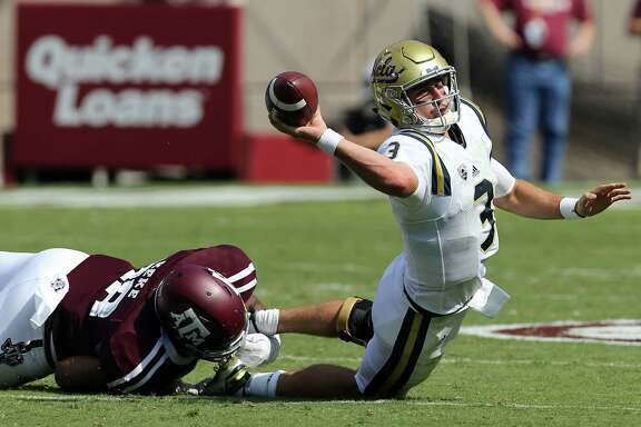 UCLA quarterback Josh Rosen (3) tries to throw the ball out of bounds as he is sacked by Texas A&M defensive lineman Kingsley Keke (88) during the second quarter of an NCAA college football game Saturday, Sept. 3, 2016, in College Station, Texas. (AP Photo/Sam Craft)