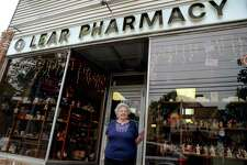 Ansonia Alderwoman Joan Radin outside her O'Lear Pharmacy on Wakelee Avenue questions whether the city should be spending $480,000 on the $4.8 million reconstruction of Wakelee when it has asked departments to cut spending.