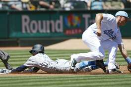 The New York Yankees' Ronald Torreyes slides safely at third as Oakland Athletics third baseman Matt Chapman, right, takes the throw in the second inning at Oakland Coliseum in Oakland, Calif., on Saturday, June 17, 2017. The A's won, 5-2. (Jim Gensheimer/Bay Area News Group/TNS)
