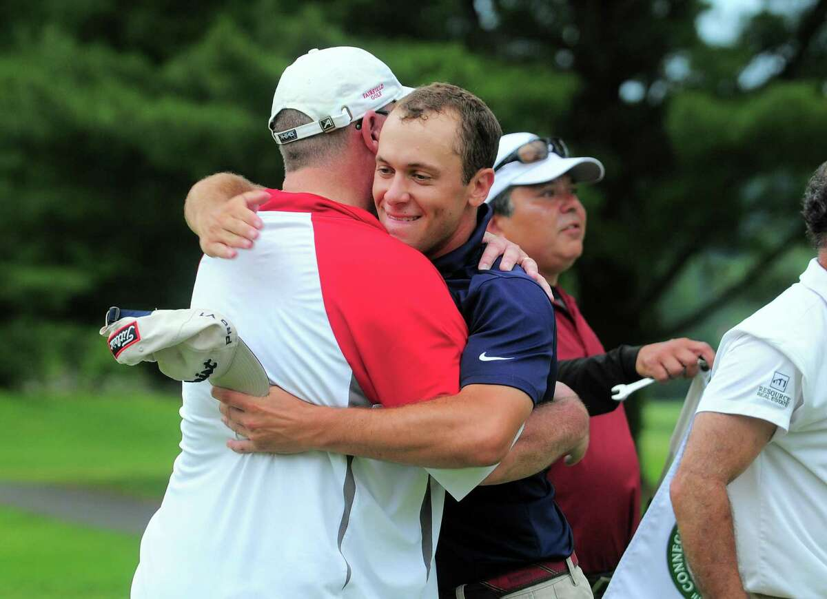 Richard Dowling hugs his father, Rick, after winning the 115th Connecticut Amateur Championship at Tashua Knolls Golf Club in Trumbull on Friday.
