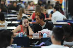 Freshman Jasmelin Ramirez and sophomore Efrain Ortiz eat lunch at Danbury High School in Danbury.