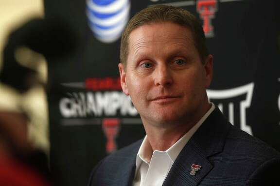 Texas Tech athletic director Kirby Hocutt speaks during a press conference in Lubbock, Texas, Monday, Feb. 9, 2015. Hocutt was appointed to the College Football Playoff selection committee Monday. Hocutt will replace Oliver Luck, the former West Virginia athletic director who has moved to a position with the NCAA.  (AP Photo/Lubbock Avalanche-Journal, Zach Long) ALL LOCAL TV OUT