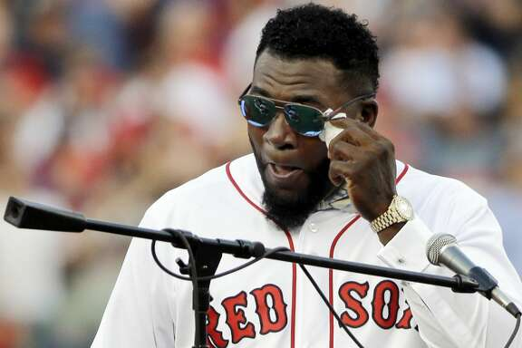 Boston Red Sox baseball great David Ortiz wipes a tear Friday, June 23, 2017, at Fenway Park in Boston as the team retired his No. 34worn when he led the franchise to three World Series titles. It will be the 11th number retired by the Red Sox. (AP Photo/Elise Amendola)