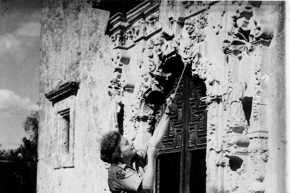 Ethel Wilson Harris rings the San José Mission bell in her Texas State Parks Board uniform, circa 1941.