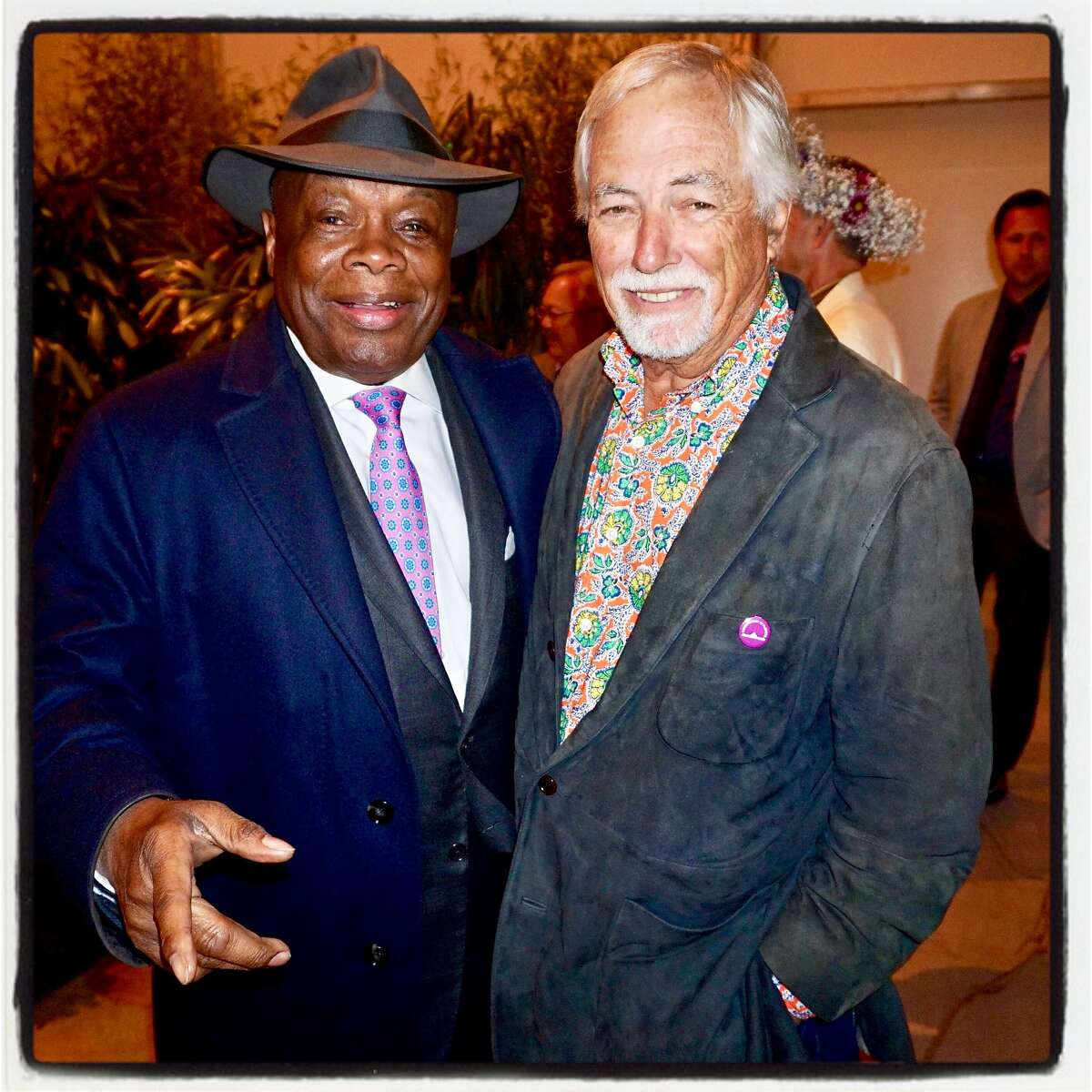"""Da Mayor Willie Brown (left) and SF Rec & Parks Commission President Mark Buell celebrate the """"Summer of Love"""" 50th Anniversary at the Conservatory of Flowers. June 21, 2017."""