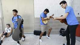 Elijah Ramirez (from right) and Zack Vara (center) have an impromptu jam session at the end of Wednesday as about 200 San Antonio Independent School District students from middle and high schools attend Mariachi Camp at Brackenridge High School during June of 2017. Students are taught the mechanics of playing and singing but more importantly according to camp director John Nieto is fostering a community with the students through Mariachi music. For one week, for eight hours each day, the all-free camp helps the young musicians to hone their skills culminating in a collaborative performance between the middle school and high school students. (Kin Man Hui/San Antonio Express-News)