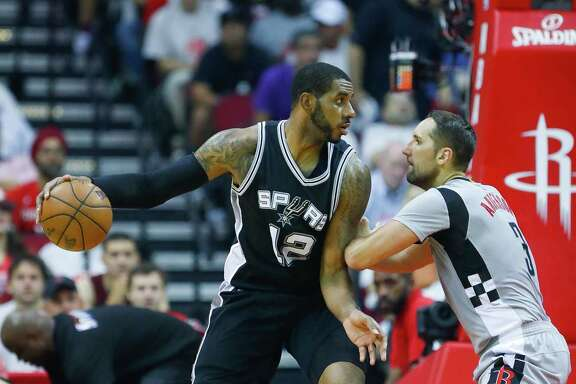 Spurs forward LaMarcus Aldridge, left, has two years left on a four-year, $84 million deal he signed in 2015, including a player option for the 2018-19 season.