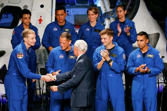 Vice President Mike Pence congratulates a new class of astronauts at the Johnson Space Center on June 7.
