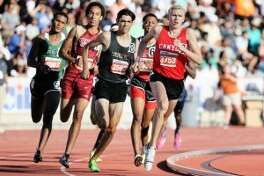 New Braunfels Canyon's Sam Worley (right) runs in the lead midway through the 6A boys 800 meter run during the UIL state track and field meet at Mike Myers Stadium in Austin on Saturday, May 13, 2017. (File photo)