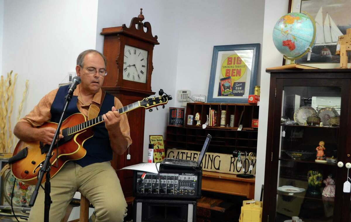 George Kachmar entertains guests with jazz guitar during the City Lights Vintage sale on Main Street in Bridgeport, Conn., on Friday June 23, 2017. The sale continues Saturday June 24, 10AM-4 PM. Several other stores are taking part in the sale with City Lights Vintage. They include: The Bridgeport FLEA, 1127 Main St., Orbitz Studios 160 Fairfield Ave. and Academy Books and Record, 305 Fairfield Ave.