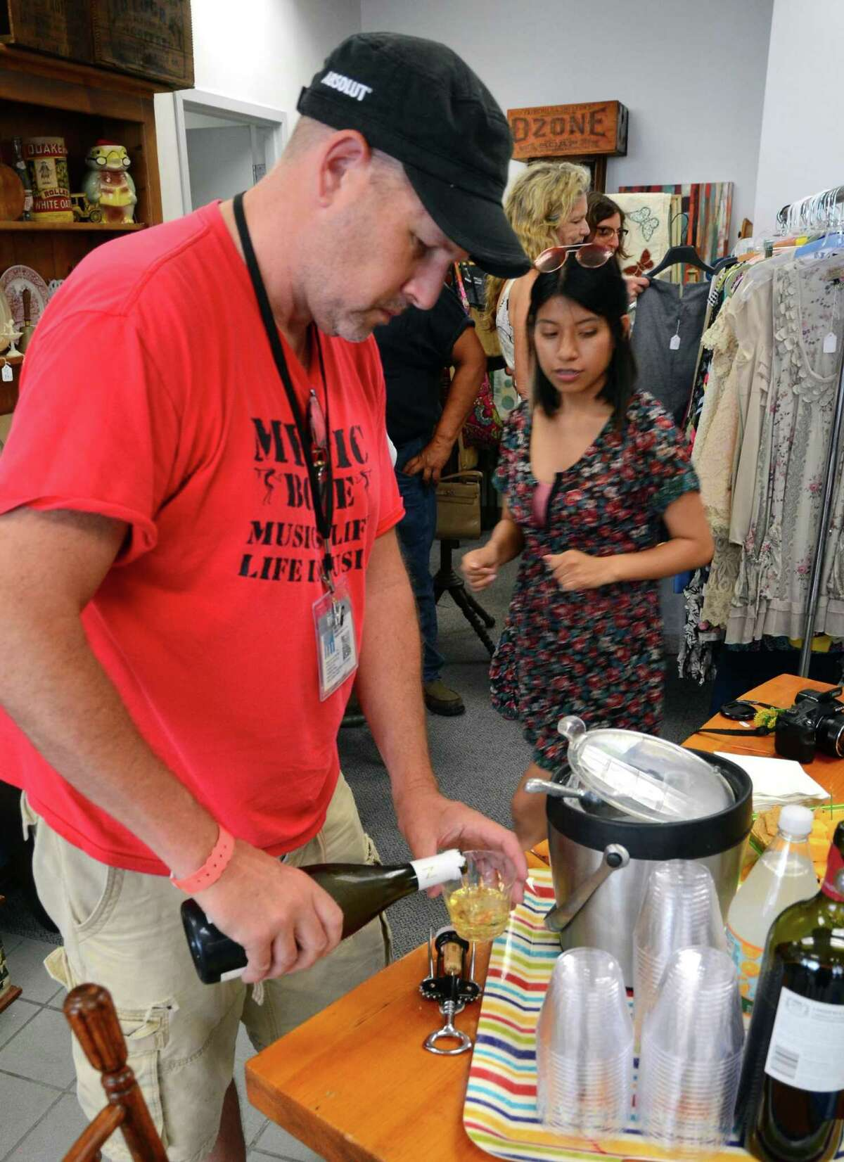 Mike Lauterborn pours a glass of wine during the City Lights Vintage sale on Main Street in Bridgeport, Conn., on Friday June 23, 2017. The sale continues Saturday June 24, 10AM-4 PM. Several other stores are taking part in the sale with City Lights Vintage. They include: The Bridgeport FLEA, 1127 Main St., Orbitz Studios 160 Fairfield Ave. and Academy Books and Record, 305 Fairfield Ave.