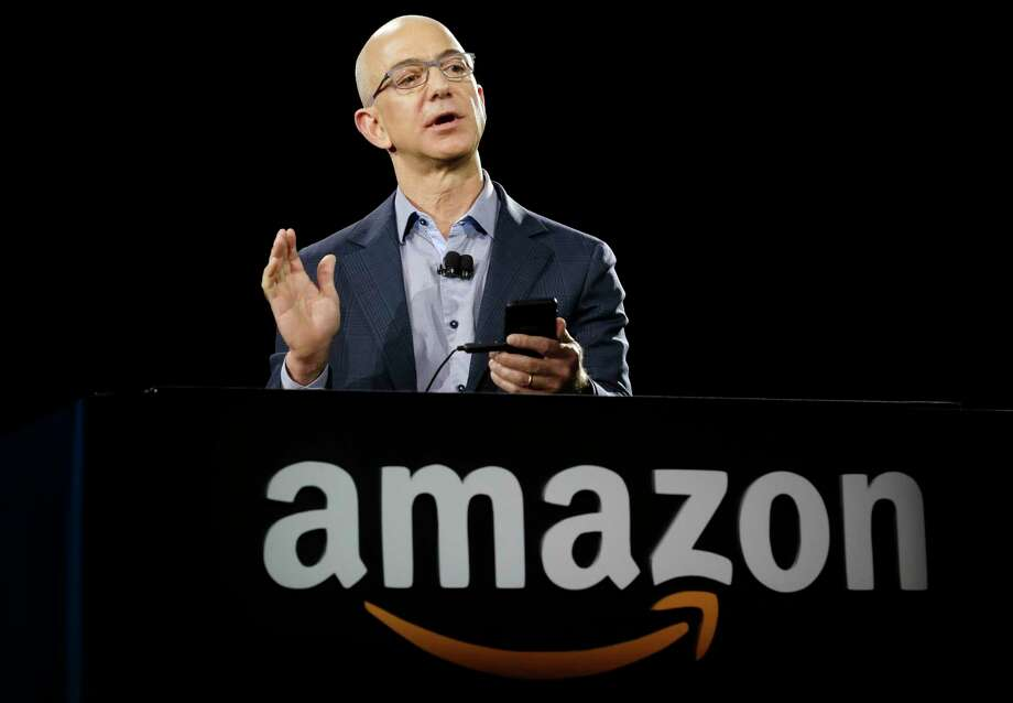 Amazon CEO Jeff Bezos demonstrates the new Amazon Fire Phone in 2014 in Seattle. (AP Photo/Ted S. Warren, File) Photo: Ted S. Warren, STF / Copyright 2017 The Associated Press. All rights reserved.
