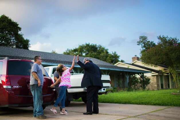 David Medina, right, one of the attorneys of the Rodriguez family, high-fives Kimberly Rodriguez, 15, accompanied by her father Juan Rodriguez, left, after the family was notified that Juan Rodriguez has been granted a 60-day reprieve by the U.S. government, Friday, June 23, 2017, in Houston. Photo: Marie D. De Jesus, Houston Chronicle / © 2017 Houston Chronicle