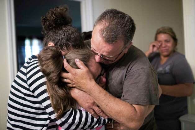 Juan Rodriguez embraces his daughters Karen Rodriguez, 18, Kimberly Rodriguez, 10, relieved that the U.S. government gave him a 60-day reprieve, Friday, June 23, 2017, in Houston. Photo: Marie D. De Jesus, Houston Chronicle / © 2017 Houston Chronicle